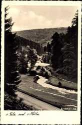 Postcard Dobel im Kreis Calw, Straßenpartie mit Flusspartie und Wald
