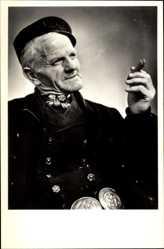 Ak Mann in Holländicher Tracht mit Zigarre, Mütze