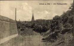 Postcard Dömitz Elbe, Am Festungsgraben, Mauer, Kirchturm, Esse