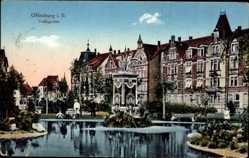 Postcard Offenburg, Blick in den Volksgarten, Gewässer, Boot, Passanten, Gebäude