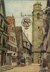 Postcard Dinkelsbühl im Kreis Ansbach Mittelfranken, Straßenpartie, Turm, Schild