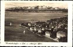 Postcard Friedrichshafen am Bodensee, Blick auf den Ort und die Alpen, Fliegeraufnahme