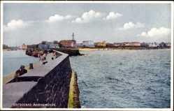 Postcard Rostock Warnemünde, Ostseebad, Blick von der Kaimauer auf den Strand