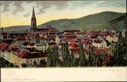 Postcard Freiburg im Breisgau, Stadtpanorama, Glockenturm, Häuser, Berge