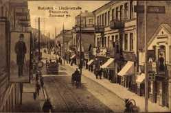 Ak Białystok Ostpreußen, Blick in die Lindenstraße, Geschäfte, Straßenbahn
