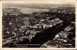 Postcard Düsseldorf am Rhein, Fliegeraufnahme von der Stadt mit Brücke