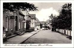 Postcard Insel Amrum in Nordfriesland, Die Strand Straße mit Friseur