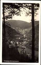Postcard Triberg im Schwarzwald, Blick durch Bäume auf den Ort