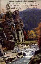Postcard Pockau im Erzgebirgskreis, kleiner Wasserfall im Pockautal, Felsen