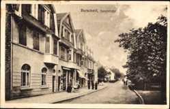Postcard Burscheid, Blick in die Hauptstraße, Passanten, Wohnhäuser