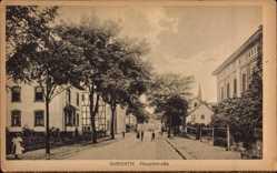 Postcard Overath, Blick in die Hauptstraße, Passanten, Fachwerk, Glockenturm