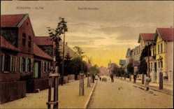 Postcard Bismark in der Altmark, Blick in die Bahnhofstraße, Mann mit Handkarren