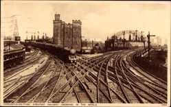 Postcard Newcastle upon Tyne North East England, Railway Crossing, Station, Train
