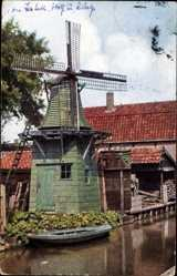 Postcard Blick auf eine Windmühle an einem Kanal, Ruderboot