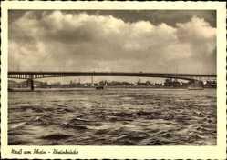 Postcard Neuss am Rhein, Blick vom Wasser auf die Rheinbrücke und Stadt