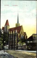 Ak Wrocław Breslau Schlesien, Straßenpartie mit Blick auf die Kreuzkirche