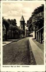 Postcard Wyk auf Föhr in Nordfriesland, Straßenpartie am Glockenturm