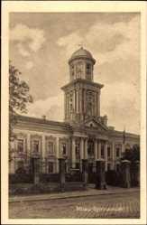 Postcard Jelgava Mitau Lettland, Ansicht vom Gymnasium, Straßenpartie