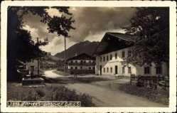 Postcard Lermoos Tirol, Straßenpartie mit Blick auf Gasthof Gries, Brunnen