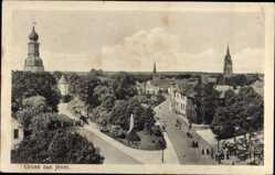 Postcard Jever in Friesland, Teilansicht mit Kirche, Straßenecke
