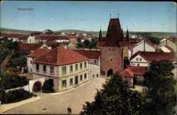 Postcard Rakovnik Mittelböhmen, Straßenpartie, Torturm, Häuser, Dächer
