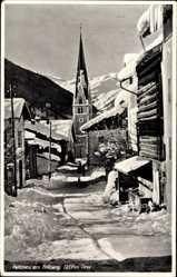 Postcard Pettneu am Arlberg Tirol Österreich, Straßenpartie im Winter, Kirche