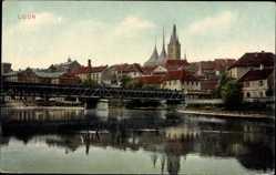 Postcard Louny Laun Reg. Aussig, Teilpanorama mit Brücke und Kirche