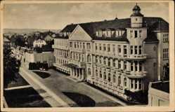 Postcard Ostseebad Kühlungsborn West, Blick auf das Parkhaus, Straßenpartie