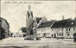Postcard Güsten im Salzlandkreis, Das Rathaus am Marktplatz, Geschäfte
