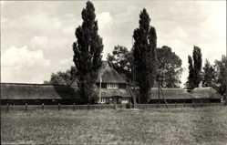 Postcard Bützow im Kreis Rostock, Blick auf den Eingang zum Schwimmbad, Wiese