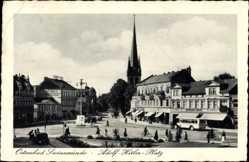 Ak Świnoujście Swinemünde Pommern, Blick auf einen Platz, Kirche, Omnibus