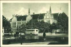 Postcard Riga Lettland, Komercskola, Blick auf die Kommerzschule, Bus