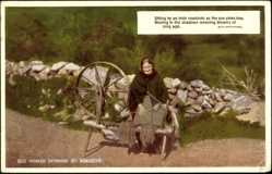 Postcard Irland, Old Woman Spinning by Roadside, sun sinks low, shadows, dreams