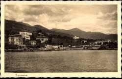 Postcard Lovran Kroatien, Blick zum Ort mit umliegender Landschaft über Gewässer