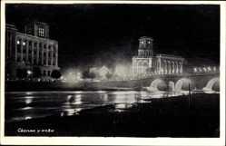 Postcard Skopje Mazedonien, Flusspartie mit Blick auf den Ort bei Nacht, Brücke